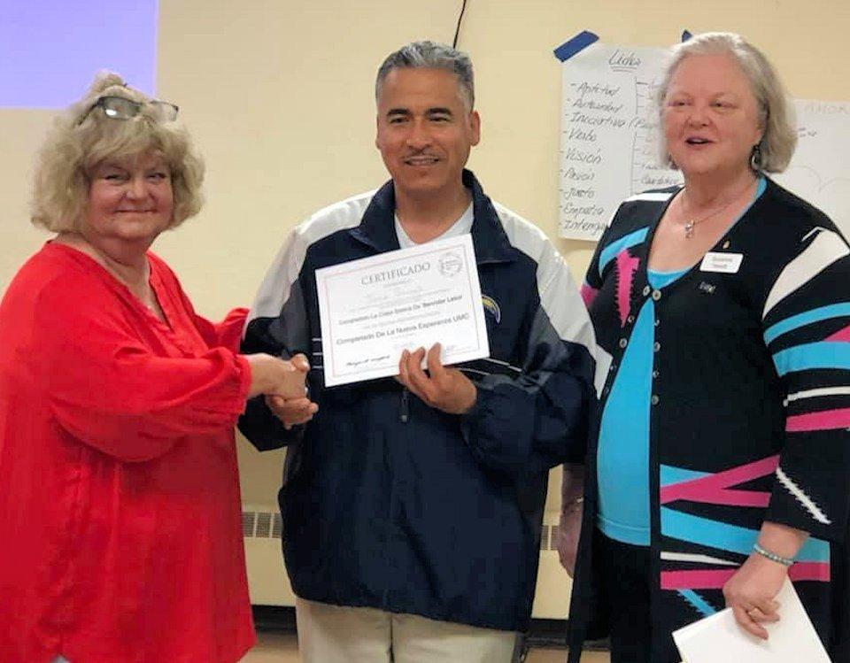 Man receiving certificate