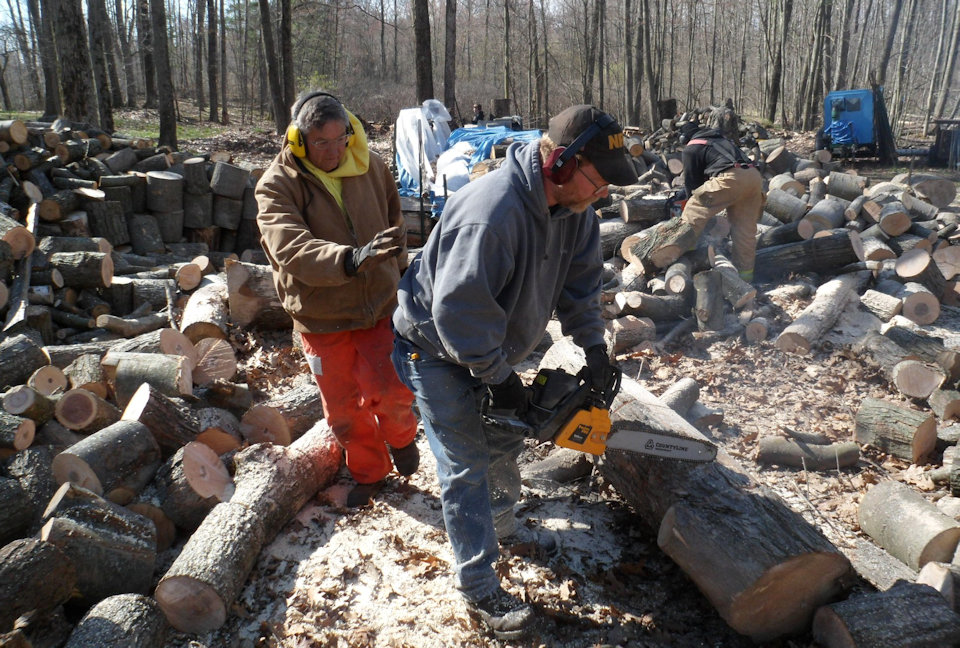 Men cutting wood.