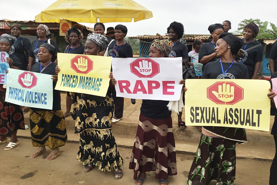 Liberian United Methodist Women demonstrate against violence to women.
