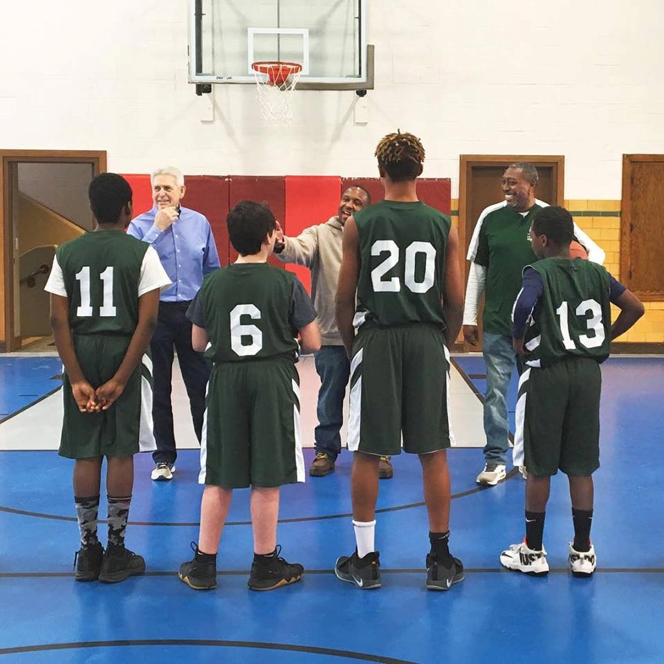 Teens on a basketball court.