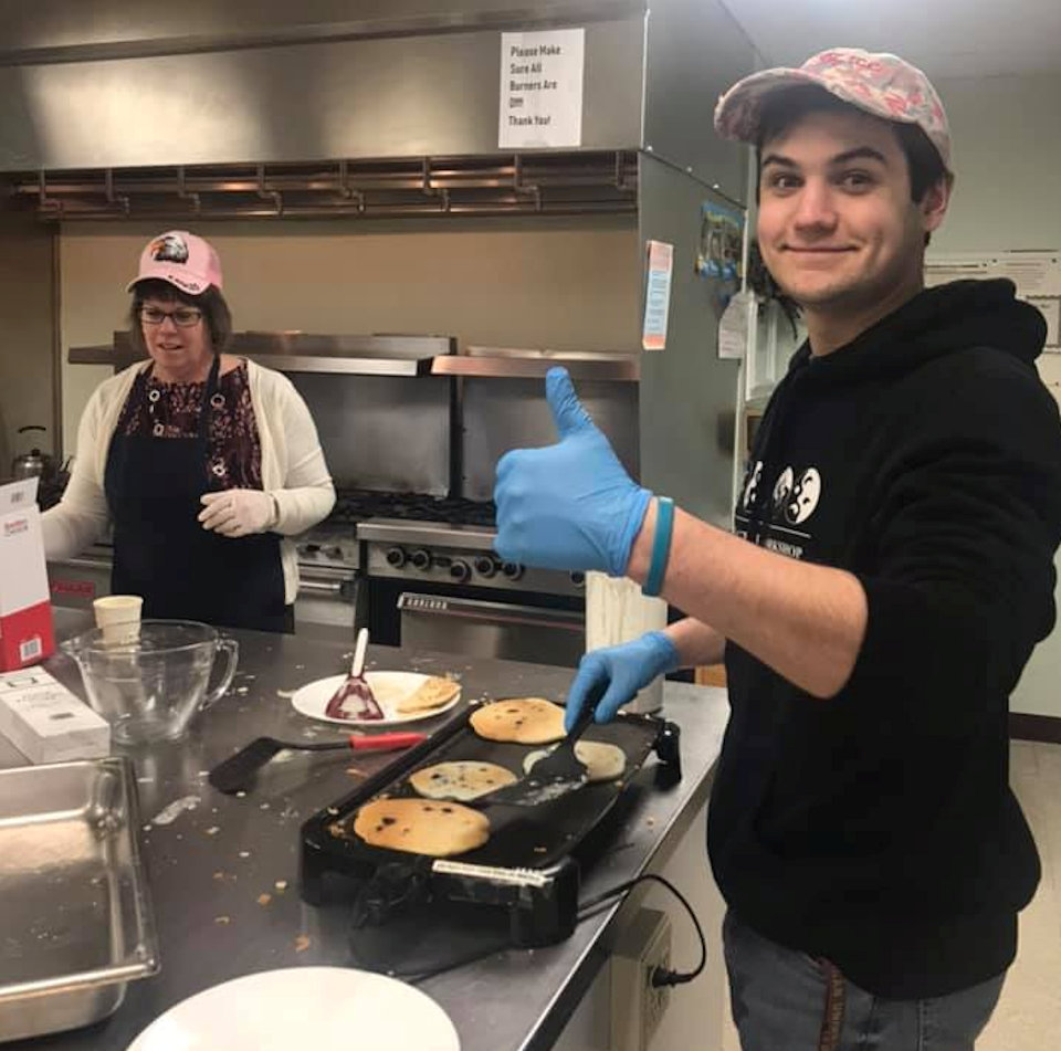 Man making pancakes