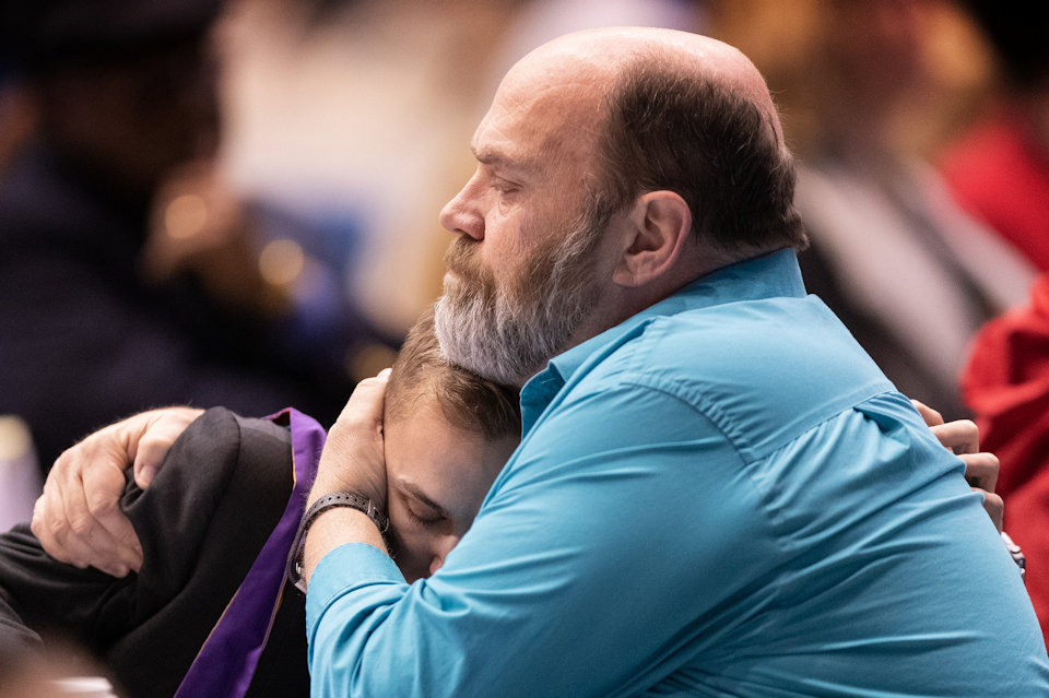 Two delegtes from Upper New York Conference embrace during Monday's afternoon session.
