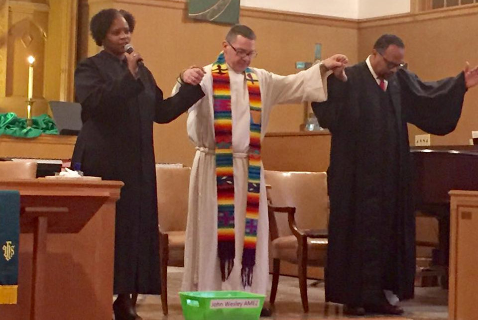 Unity Service held in Muskegon Heights February 2017. Three pastors holding hands.