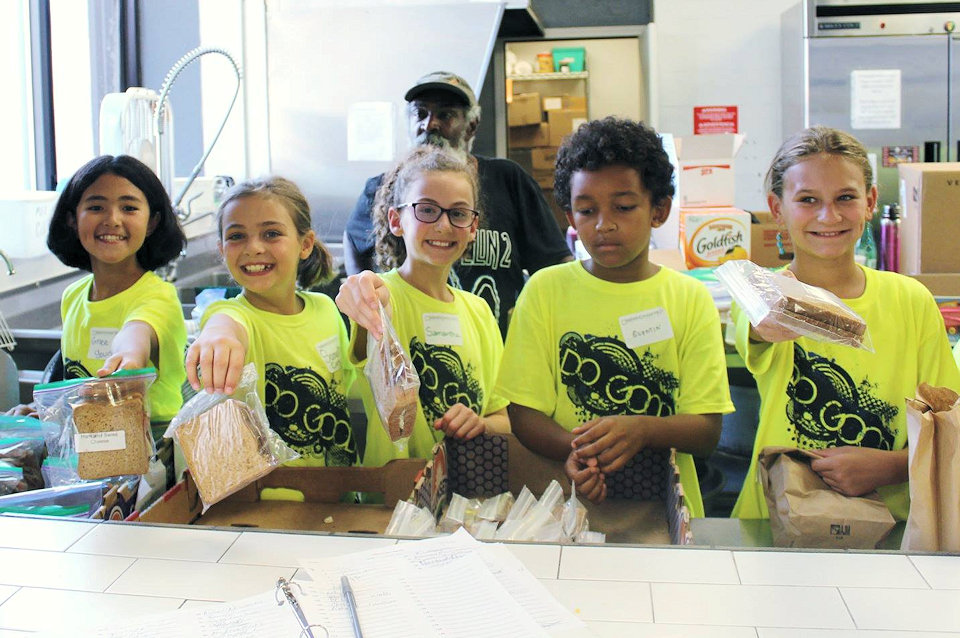 Children serve lunch at NOAH Project in downtown Detroit.