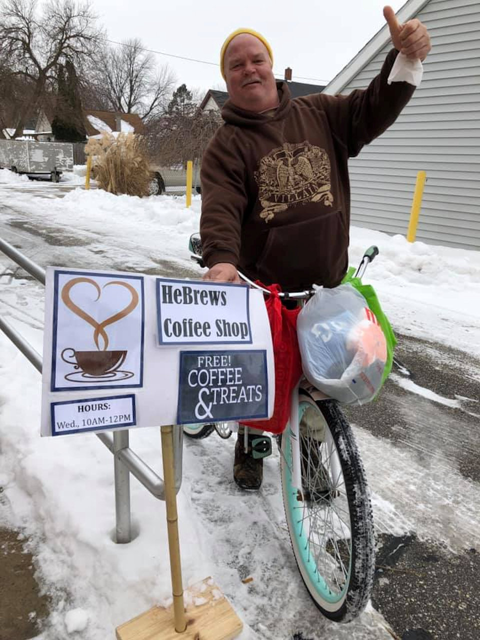 Man on bike goes for HeBrews Coffee