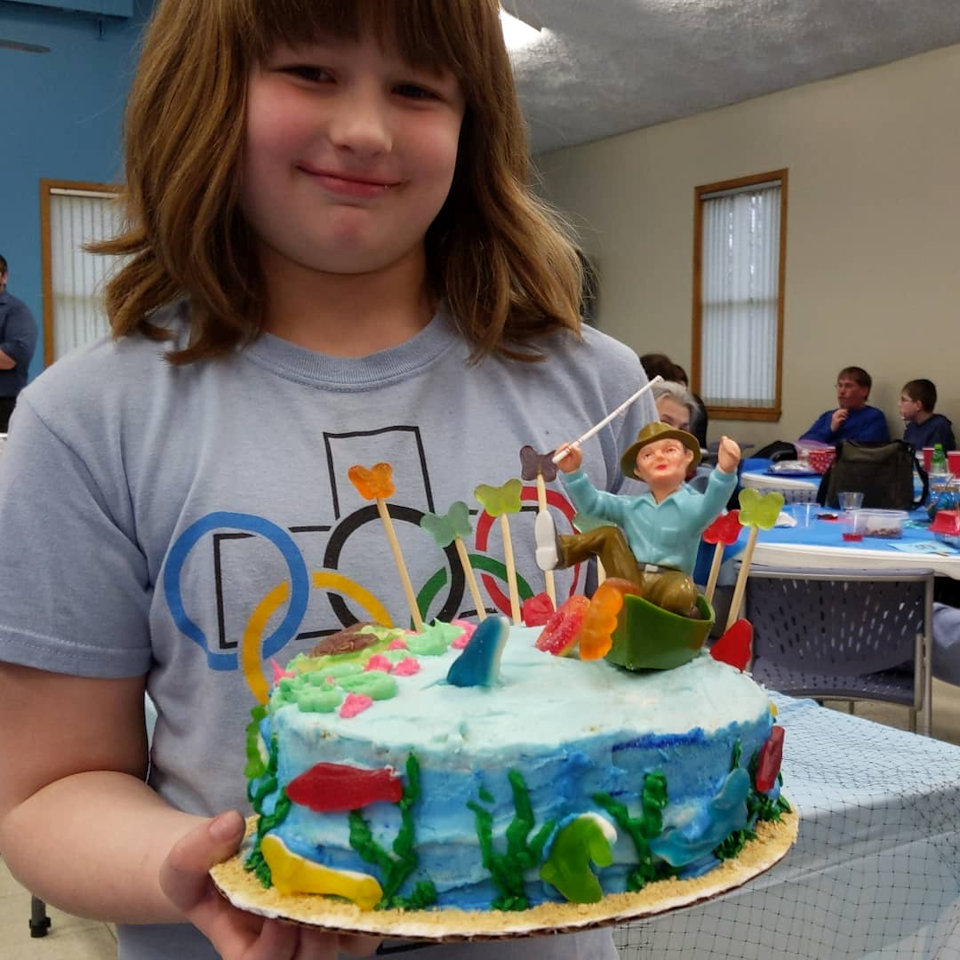 Cake auction supports camp scholarships