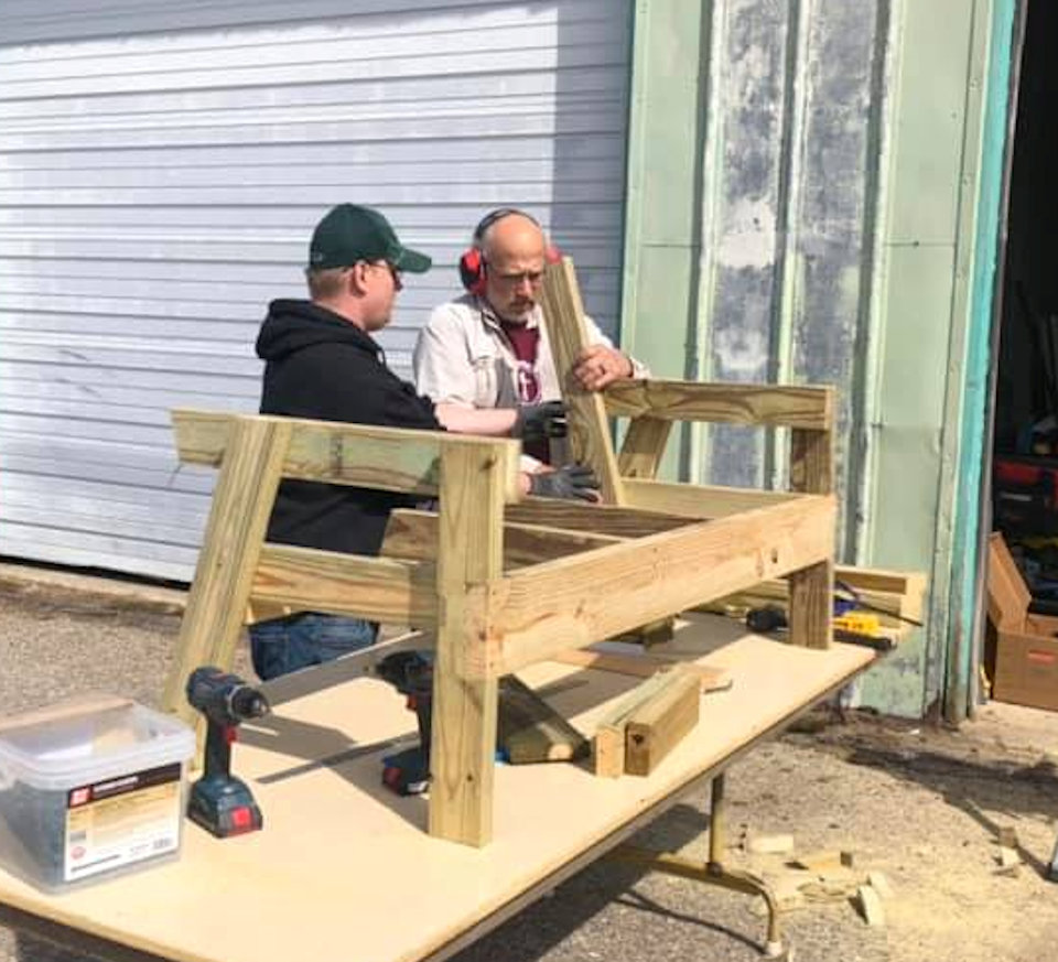 Men working on a bench