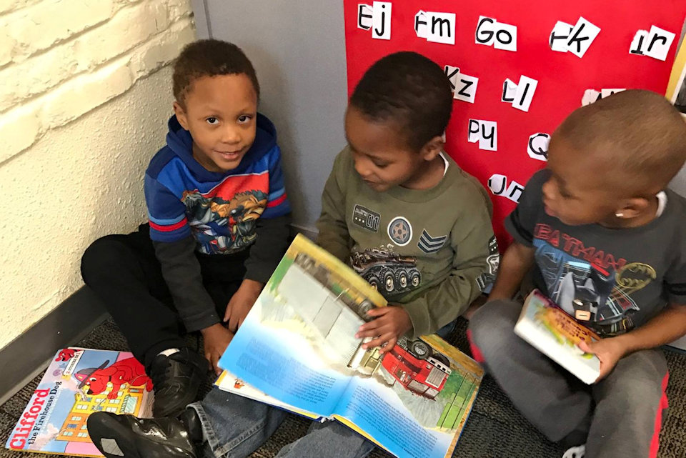 Children learning to read at United Methodist Community House in Grand Rapids