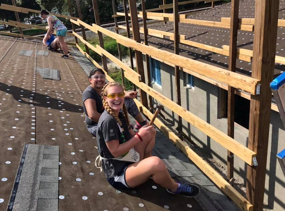 Students working on roof for Habitat