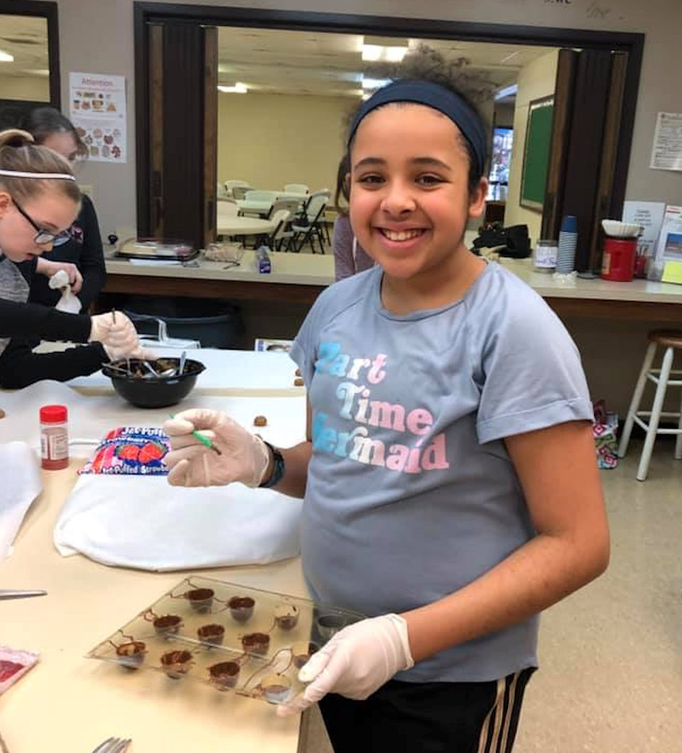 Girl making candy
