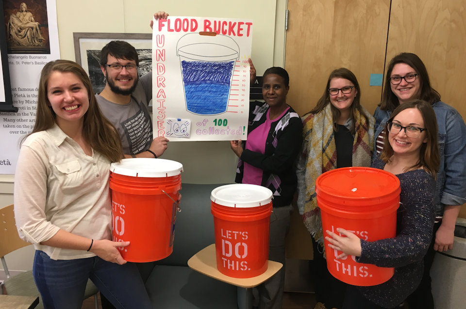 University students with Cleaning Buckets