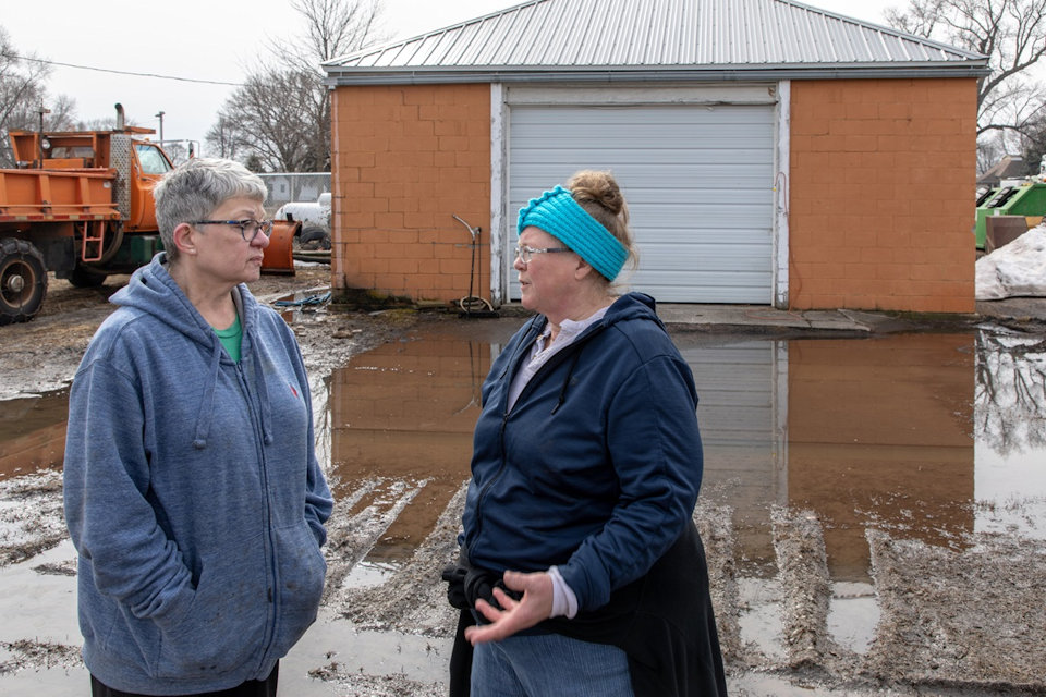 Women in flooded driveway