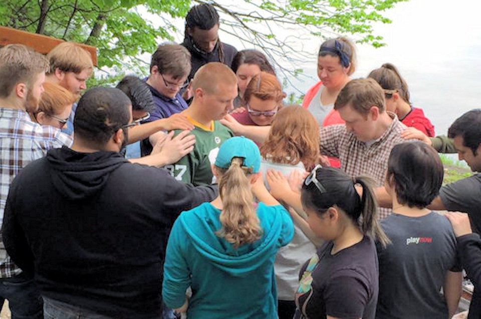 Mission Interns being blessed during training at Lake Louise