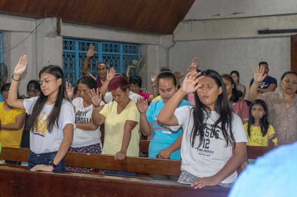 Filipino people in worship.