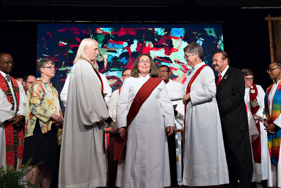 Woman being ordained a deacon in the United Methodist Church