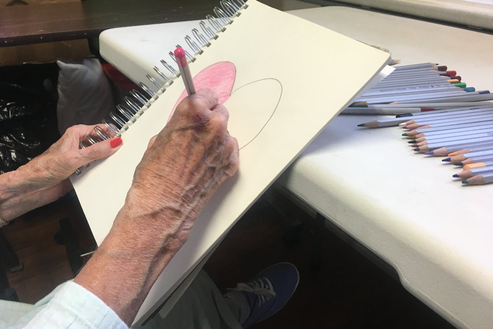 Woman's hands making a drawing
