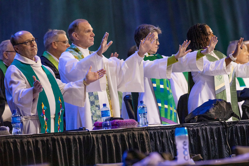 Bishops praying at General Conference 2019 before the debate begins