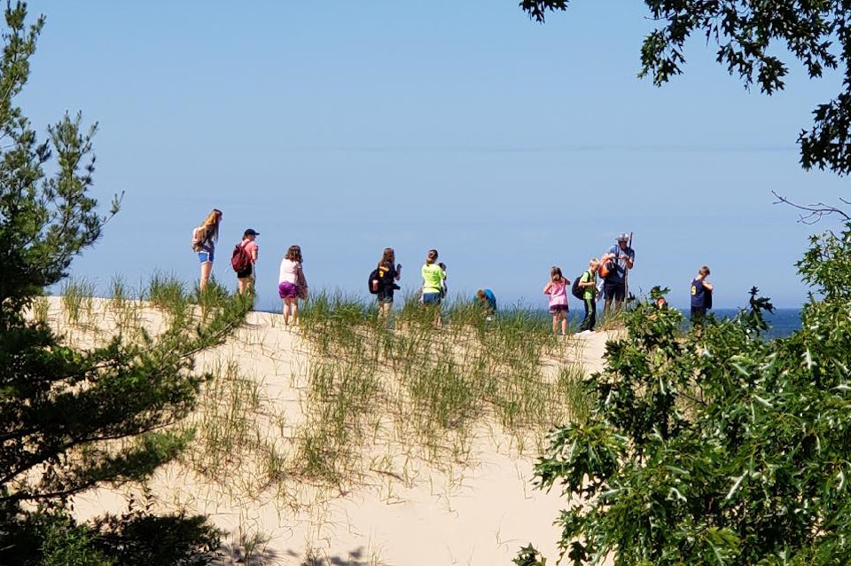 People on the dunes at Lake Michigan