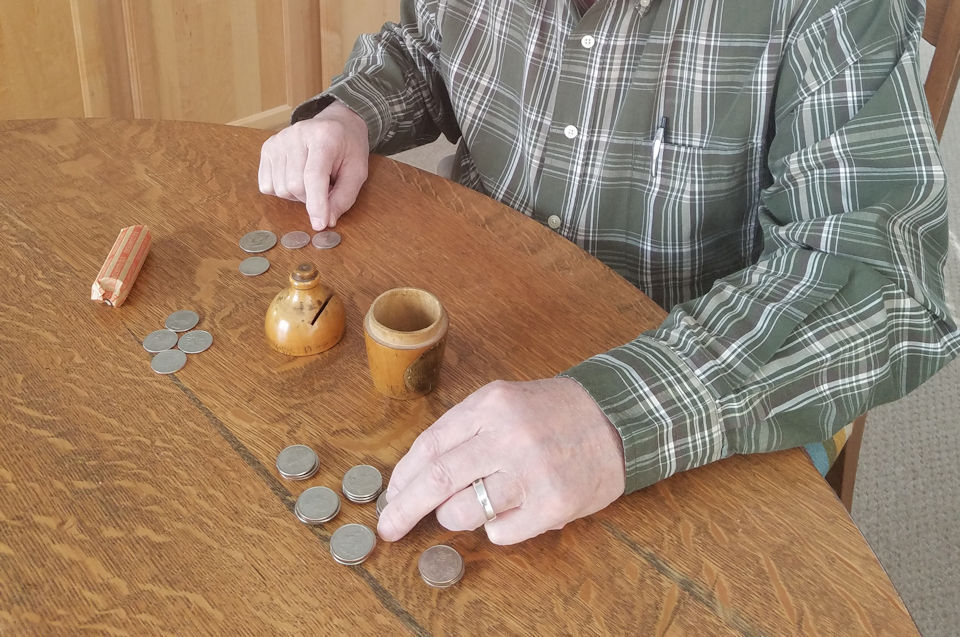 Man counting coins.