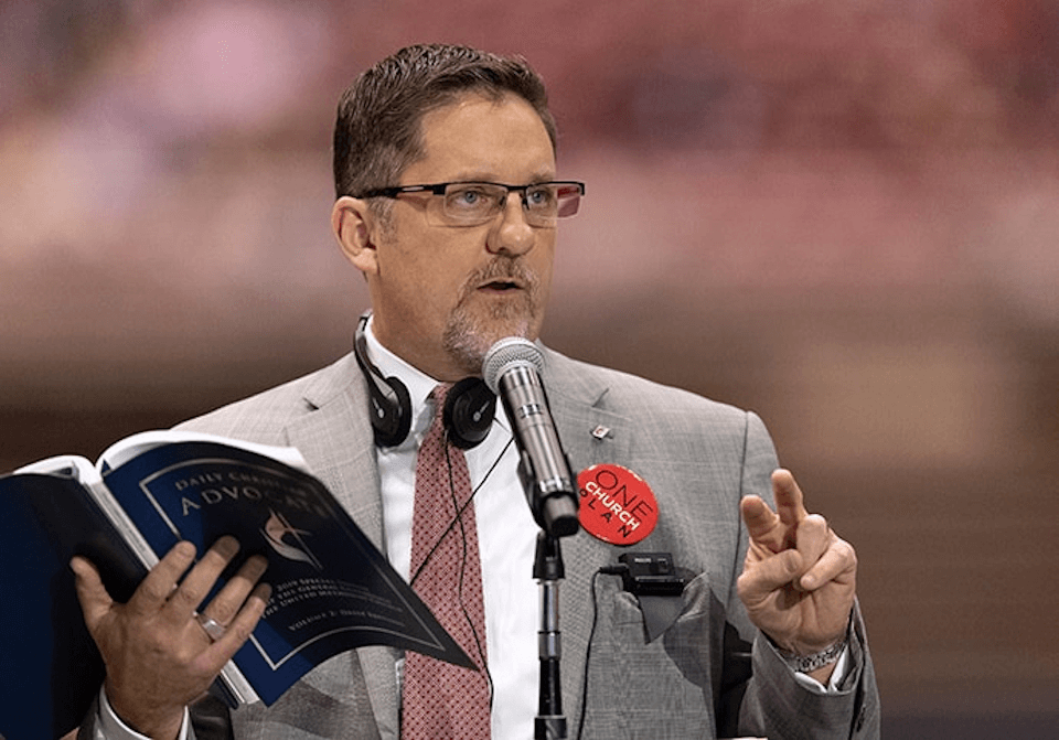 Man at microphone at General Conference 2019