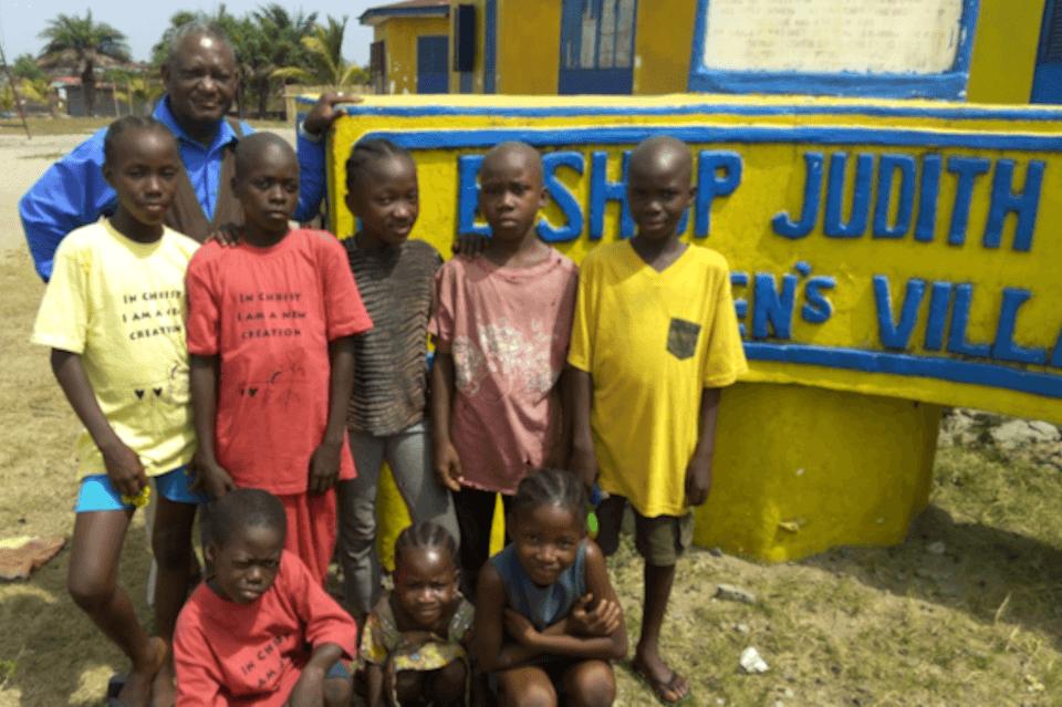 Robert Sieh with orphans at the Judith Craig Children's Village
