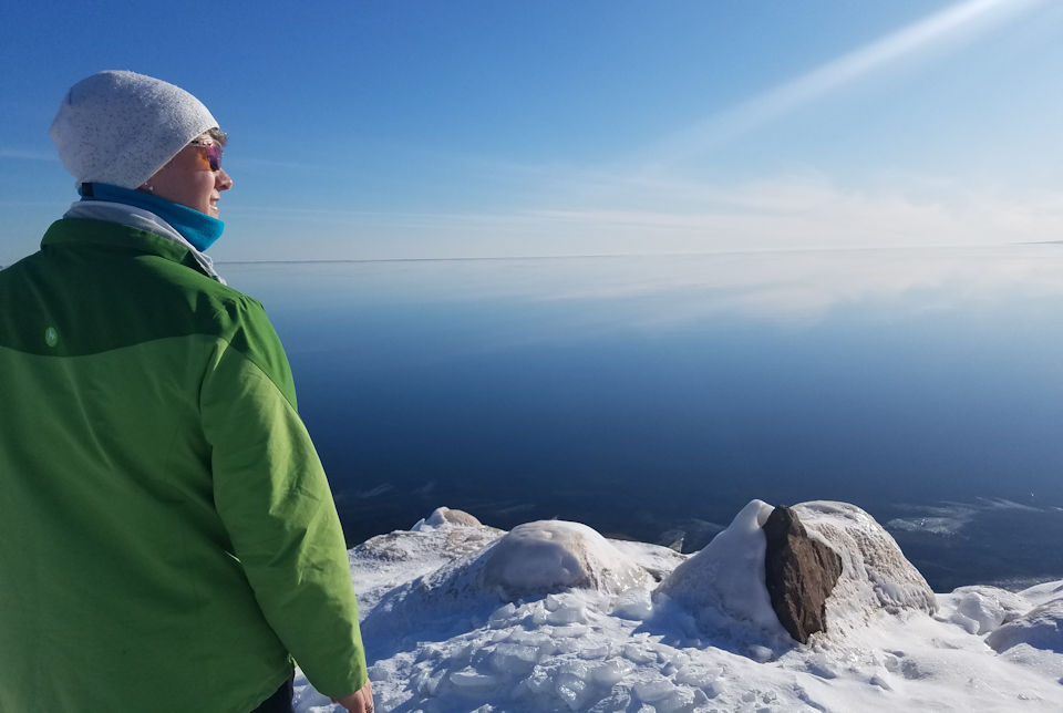Woman looking over frozen Lake Superior