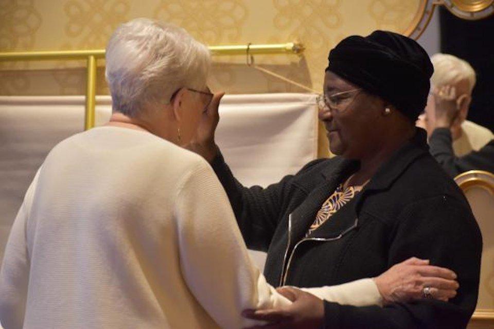 Two women bishops renewing baptism