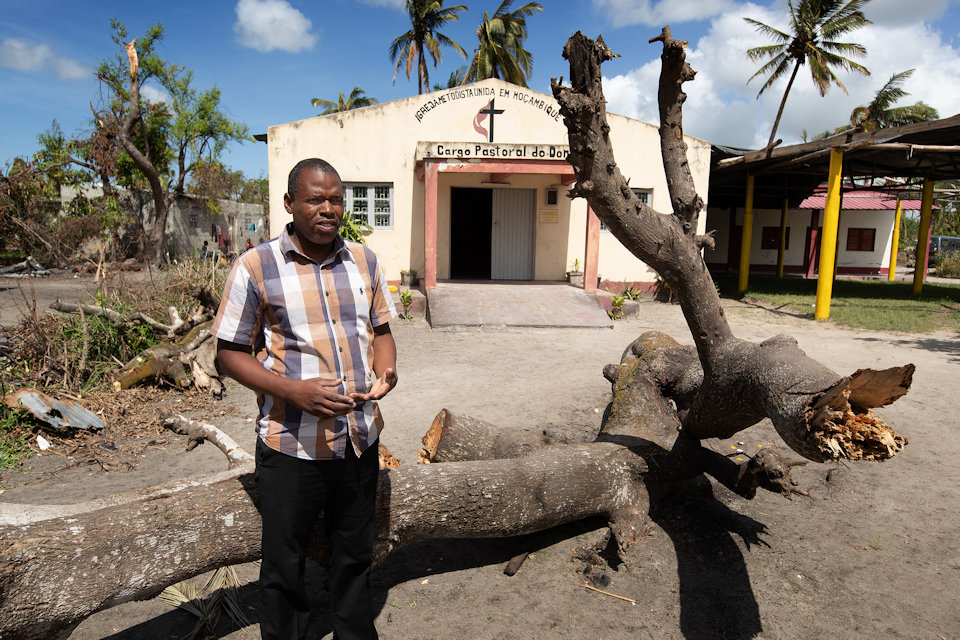 Pastor in front of church in Mozambique