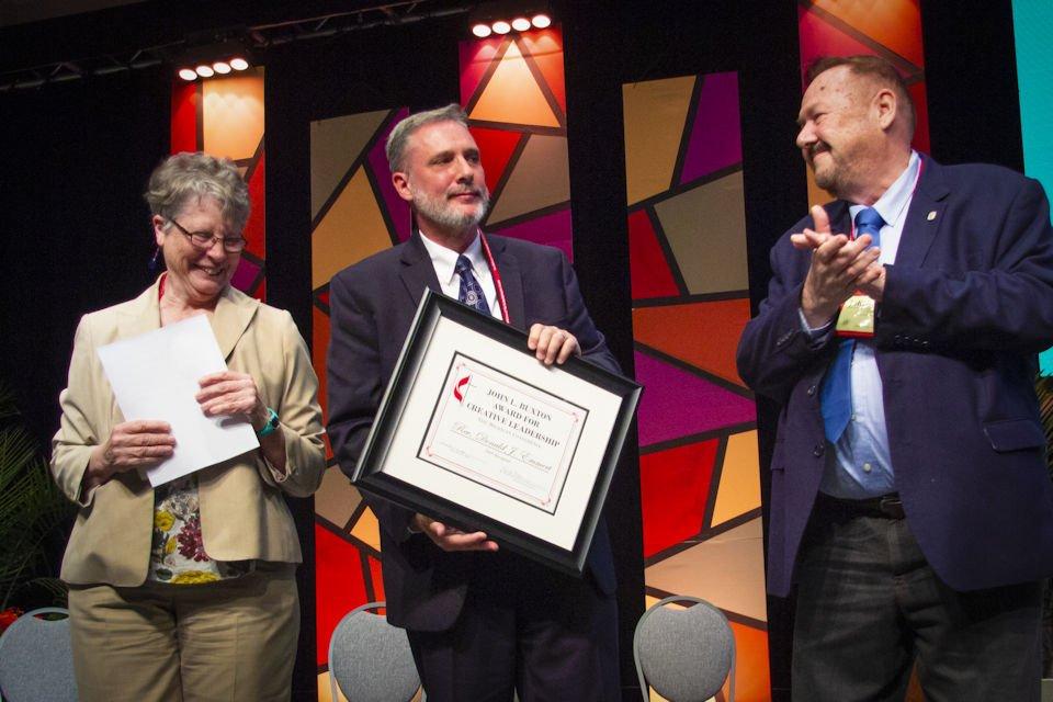 Don Emmert holding Buxton Award