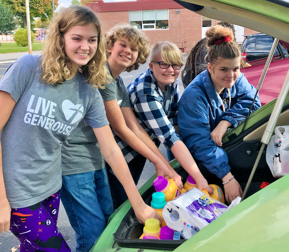 Youth fill car trunk