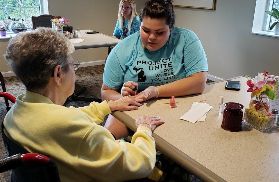 Volunteer polishes nails of Clark resident