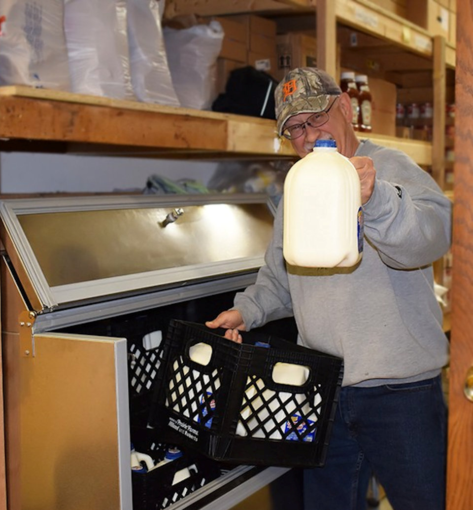 Man with milk jug