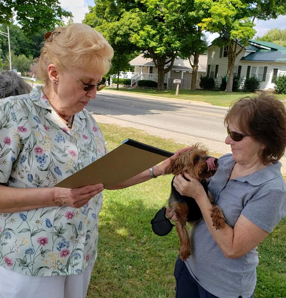 Pastor blesses dog