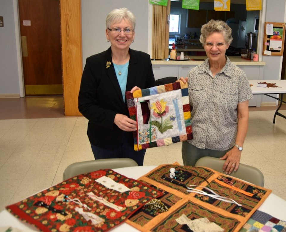 Women with quilts