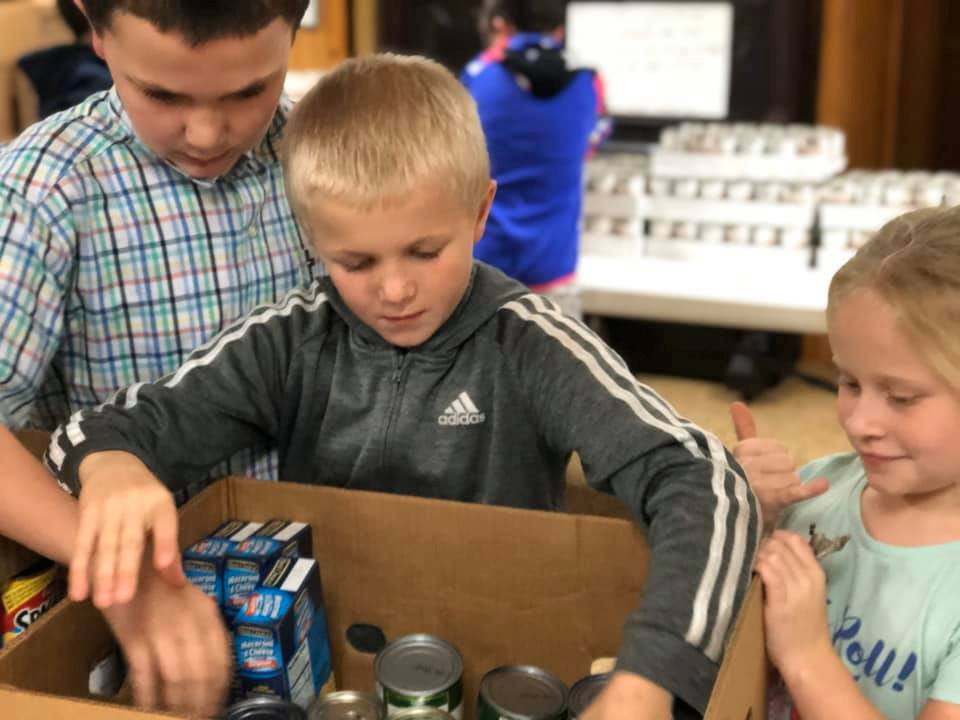 Children packing food boxes