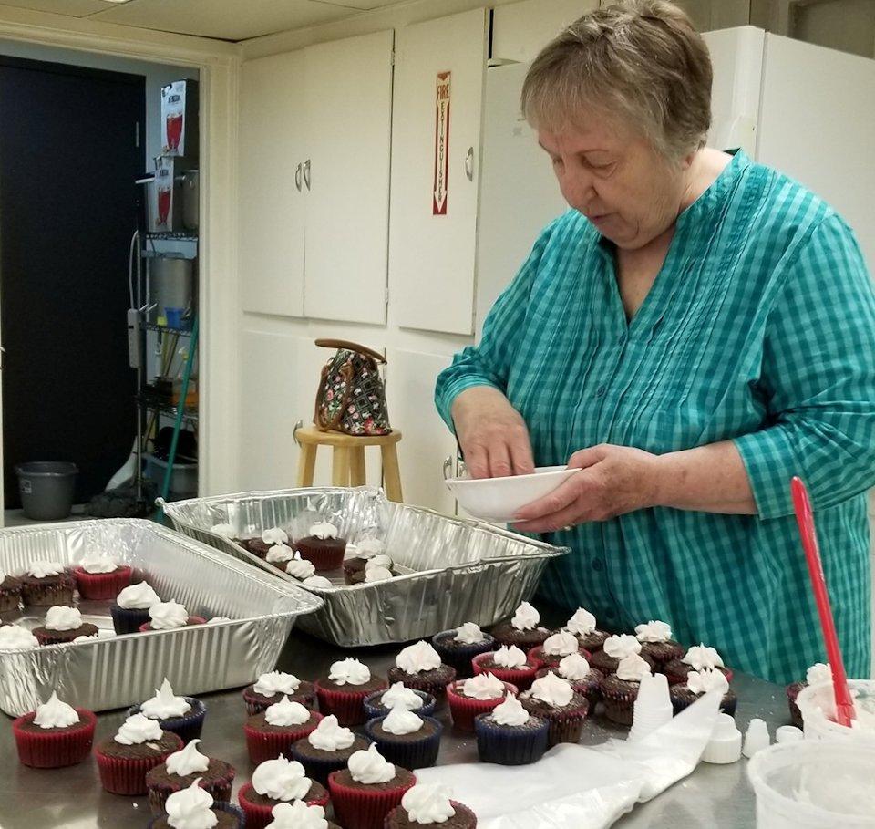 Woman prepares dessert at Farwell UMC