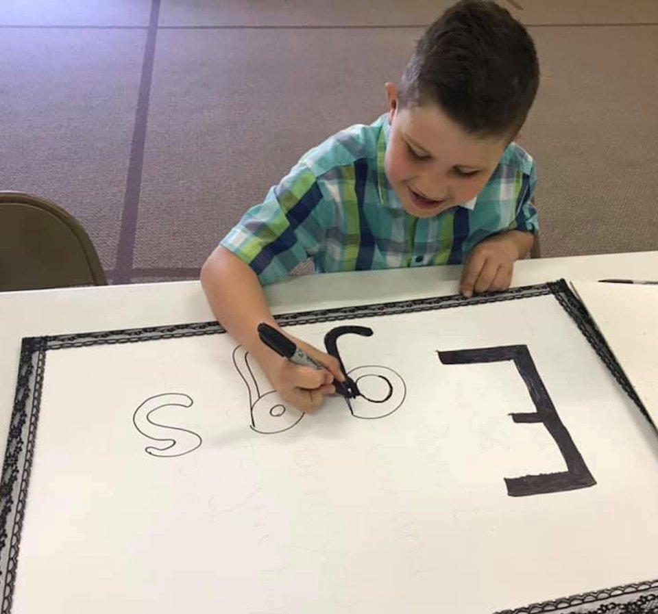 Boy making sign