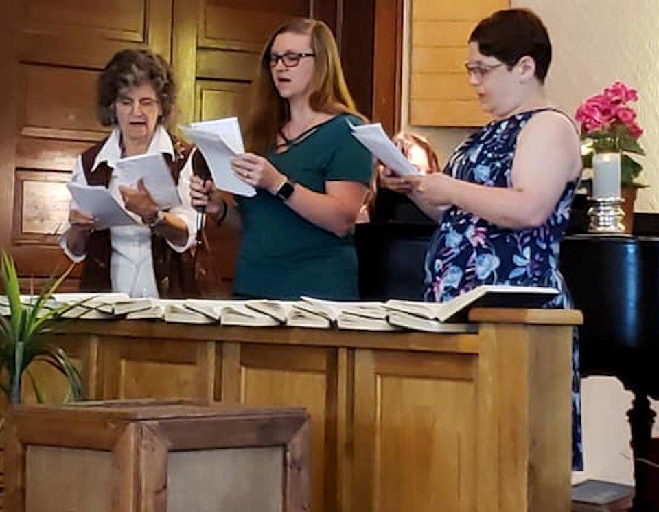 Singing in worship.