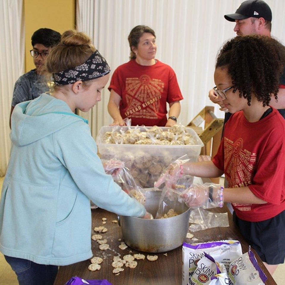 Kids filling food bags