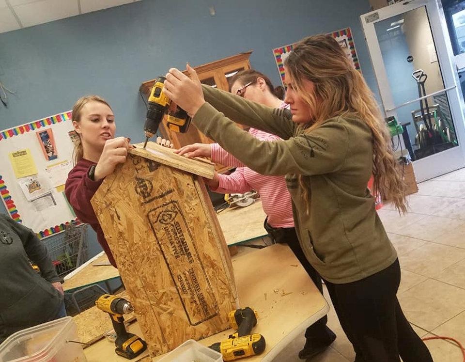 Women working on wood project