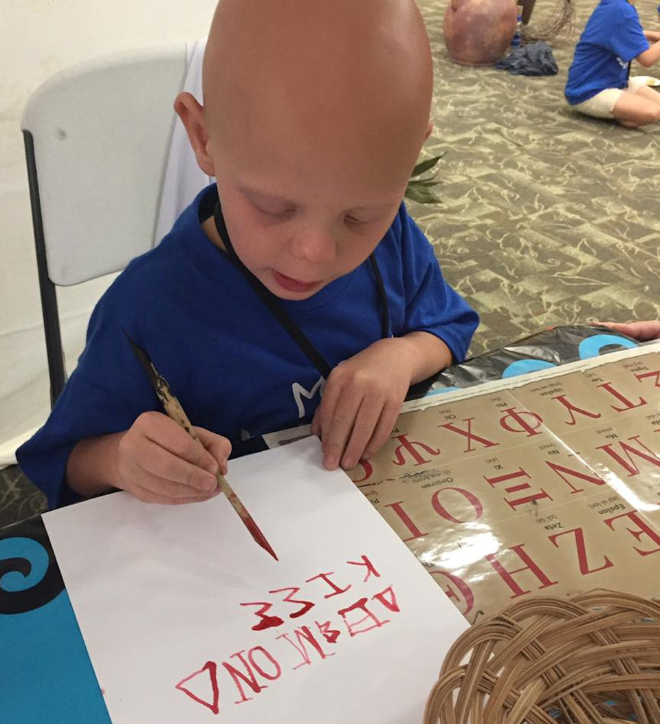 Children practicin Greek letters at VBS