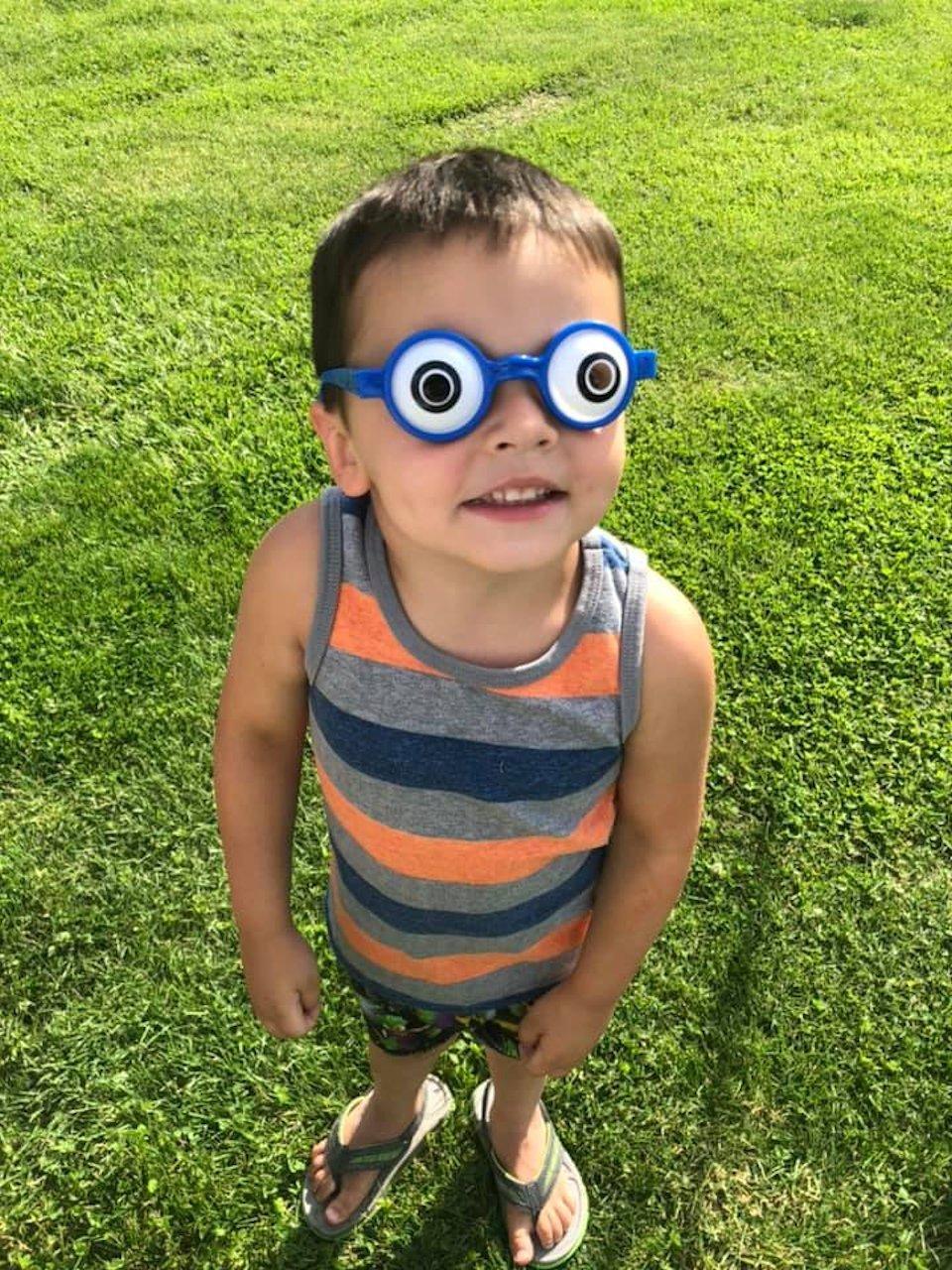 Boy with bug-eyed glasses