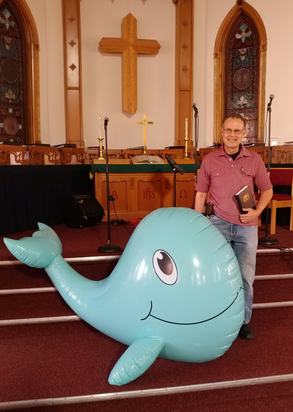 Pastor with whale