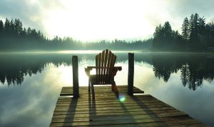 Chair on a dock by the lake