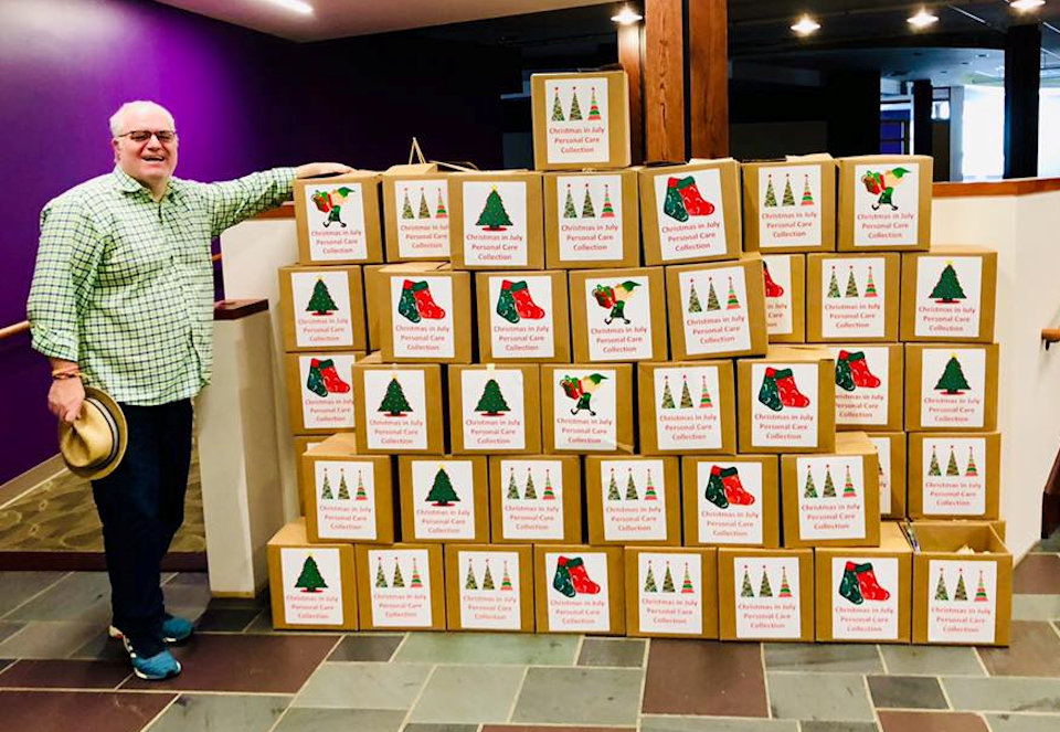 Pastor Jeff Nelson with Christmas boxes