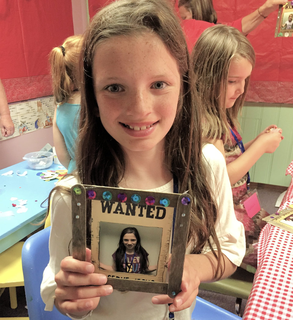Girl holding VBS project
