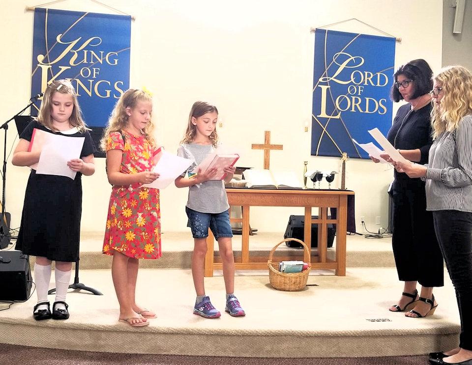 Girls receiving Bibles