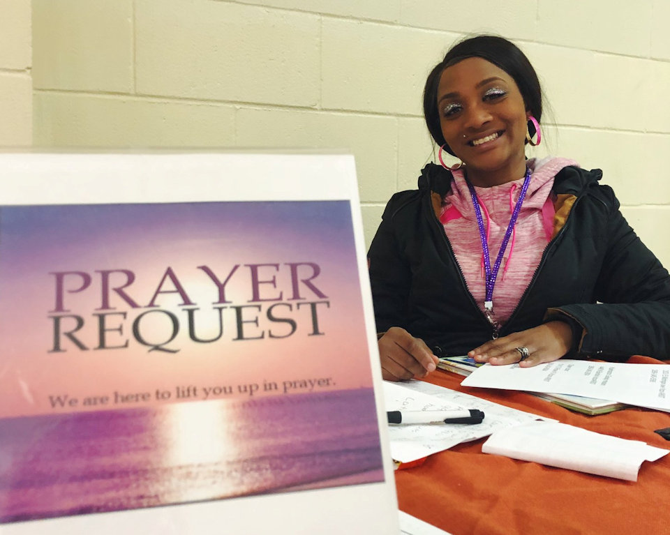 Young woman at prayer desk