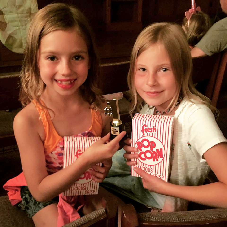 Two girls with movie popcorn