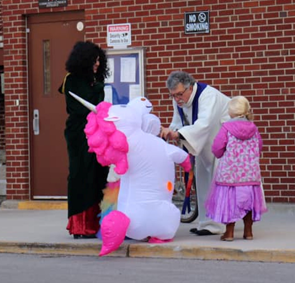 Pastor blesses trick or treaters